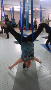 Trying aerial yoga (and obviously having fun)!